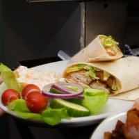 Crispy chicken wrap with salad